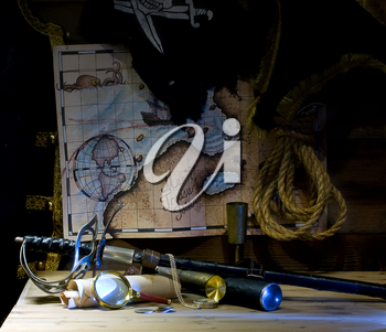 Pirate accessories and weapons laid out near the treasure map