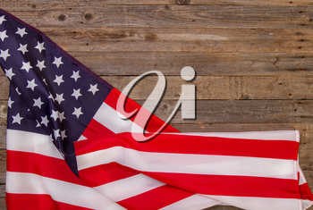 starry striped flag of United States of America on rough wooden background