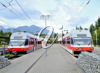 Railway station Strbske pleso with commuter electric trains at platforms in High Tatras.