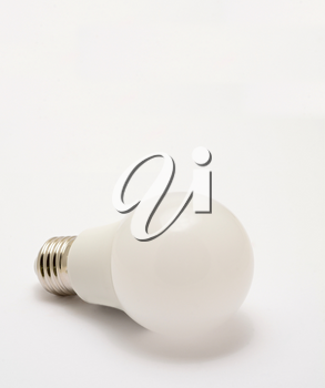 Close up of standard led light bulb on a white background.