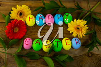 Easter eggs and leaves on a dark wooden background. Easter background. Easter eggs. Easter. Easter symbol.  Easter card. Easter greetings. Happy Easter