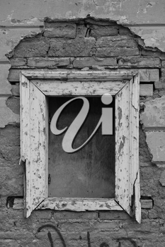 Empty window frame broken brick wall grunge background. Black and white.