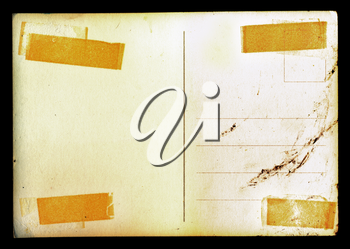 Vintage blank postcard background with adhesive tape stains and ink smudge.